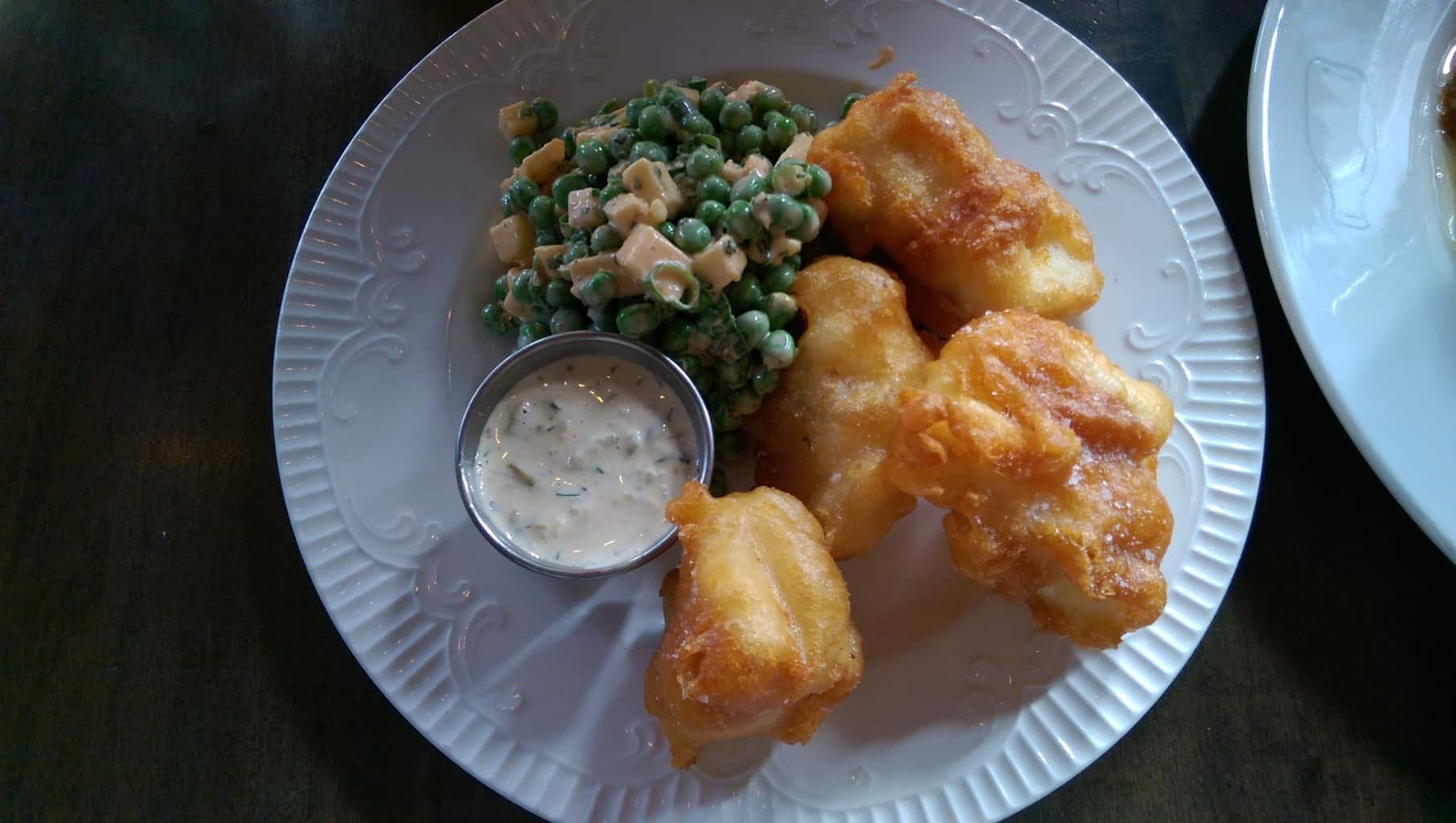 beer battered fish with tartar sauce; peas salad, cheddar and thousand island sauce