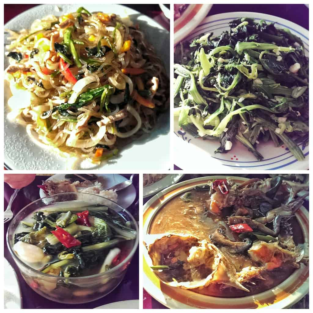 From top left clockwise: japchae, spinach salad, ganjang gejang, and mul-kimchi