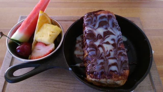 banana & frangelico cream cheese stuffed french toast topped with nutella & condensed milk