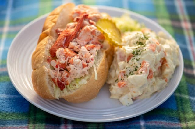 classic a nova scotia lobster roll served with potato salad